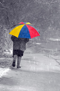 colourful-umbrella-and-man by George Hodan